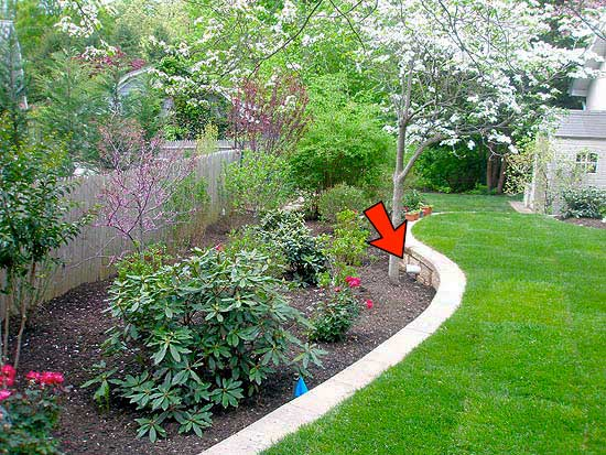 Completed Drainage System with Landscaping Ends Here (Red Arrow) Allowing for Runoff Within Property Lines